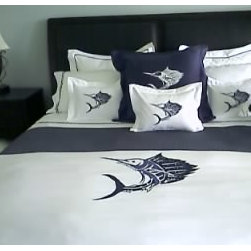 In Store Merchandise - This bed set was created to have a big game fish theme. The sailfish on the coverlet has over 700,000 stitches. Picture by: Pioneer Linens' Staff