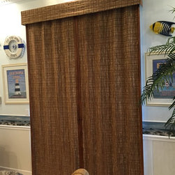 Averte Natural Fold - Averte' Natural Fold is a beautiful window and a great vertical blind alternative. Gorgeous woven wood natural materials and available with privacy or blackout lining.   Installation by Budget Blinds of Clermont