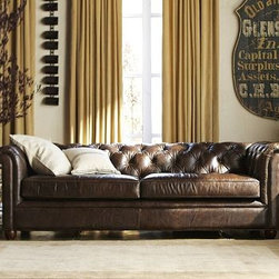 """Chesterfield Leather Upholstered Grand Sofa, Polyester Wrap Cushions, Leather Co - With its sheltering arms and deeply tufted upholstery, the Chesterfield Sofa is synonymous with comfort. Our leather sofa retains all the fine points of the Edwardian originals, creating furniture that's perfect for relaxing. 96"""" w x 42"""" d x 30.5"""" h {{link path='pages/popups/PB-FG-Chest-2.html' class='popup' width='720' height='800'}}View the dimension diagram for more information{{/link}}. {{link path='pages/popups/PB-FG-Chest-3.html' class='popup' width='720' height='800'}}The fit & measuring guide should be read prior to placing your order{{/link}}. Seat cushions have a polyester wrap for a tailored and neat look. For shipping and return information, click on the shipping info tab."""