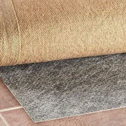 Home Decorators Collection - All-Surface Rug Pad - Use this area rug pad to help keep your rug from slipping while adding to the longevity of your favorite floor covering. It also provides an extra-cushiony feel underfoot for added comfort. Buy yours today.Helps protect your floors from dye transfer, marring or scratching.Easy to trim for the perfect fit.Great for use even on uneven or hard surfaces.Ideal for rug-to-carpet application.