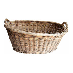 Wicker Laundry Basket - A antique gathering basket found in France. Detailed with two handles and a well-supported bottom. Desirable time-worn patina, great for folded blankets or linens.