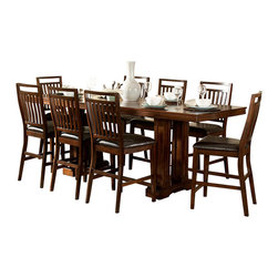 Homelegance - Homelegance Everett 9 Piece Trestle Counter Height Table Set in Cherry - Create a casual feeling in your formal dining room with the classic Everett Collection. Arts and Crafts styling is used to add an air of tradition to this new dining concept. The gathering height table is 96 inches long allowing for the casual atmosphere created by counter height seating while still allowing for large groups to gather. The dining group s trestle base table, warm cherry finish over oak veneers with bowtie inlay accents perfectly exemplifies the Arts and Crafts style of this new dining configuration. Also available in Medium Oak finish.