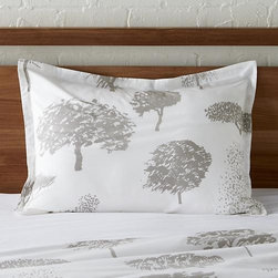 "Marimekko Rantapuisto Grey Standard Sham - Global forest plants grey silhouettes of the world's trees on crisp white cotton percale bedding, artfully rendered in designer Fujiwo Ishimoto's painted design. Inspired by his observations of nature in many settings, the pattern is named Rantapuisto, a Finnish word meaning ""beach park."" Sham has a 1"" flange and generous overlapping back closure. Bed pillows available."