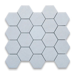 "Stone Center Corp - Thassos White Marble Hexagon Mosaic Tile 3 inch Polished - Thassos white marble 3"" (from point to point) hexagon pieces mounted on a sturdy mesh tile sheet"