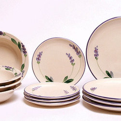 Lavender Dinnerware Set - eaturing lovely purple lavender with green leaves circling the rim of all of the pieces of our Lavender Dinnerware Set.  This set is dishwasher and microwave safe, oven proof and 100% lead free.   Available in Classic Plate or Coupe Plate design and Service for 1 or 4.  Handcrafted and hand painted in the USA.  Due to the handmade nature of this product, it may vary slightly from the photo depicted.