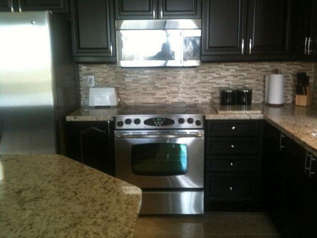 Modern Kitchen by Under The Sun Home Renovations Ltd.