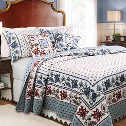 None - Madeline 3-piece Quilt Set - Update your bed with this floral cotton quilt set from Madeline. The set includes a quilt and matching pillow shams for a coordinated look. The foulard-print quilt is reversible and is oversized to give better coverage for deeper mattresses.