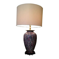 Paisley Ceramic Lamp - A handsomely styled, unusual pastel paisley ceramic lamp. This artful piece will be a stunning accent on a nightstand or side table. Its stylish design is exciting and eye-catching.