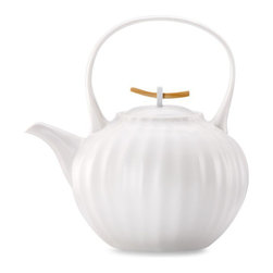 Donna Karan Lenox Porcelain Touch Teapot - I like this teapot for its pure and simple style. It's a timeless piece that would look nice in the company of any dishes you already have.