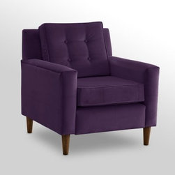 Aubergine Velvet Crate Chair - There aren't many who can resist the look and comfort of the Aubergine Velvet Crate Chair. Its retro feel and purple upholstery make it the centerpiece of any room. Plush cushions, a tufted cushion back, and tapered legs complete the look of this fashion-forward chair. Perfect for any room, it lets you create a décor that makes a statement.About Skyline Furniture Manufacturing Inc.Skyline Furniture was founded in 1948 with the goal of producing stylish, affordable, quality furniture for the home. After more than 50 years, this family-run business is still designing and manufacturing unique products that meet the ever-changing demands of the modern home furnishing industry. Located in the south suburbs of Chicago, the company produces a wide variety of innovative products for the home, including chairs, headboards, benches, and coffee tables.