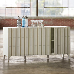 Palu Ltd - Palu Montour Buffet - The antique white Palu Montour buffet delivers subtle yet sophisticated storage. Linear moldings on the piece's cabinet doors accent its geometric frame for dimensional depth. 69��_W x 20��_D x 34.5��_H; Three cabinet doors; Six interior shelves; Mindi wood; Stainless steel hardware