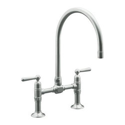 "Kohler - Kohler k-7337-4-BS Brushed Stainless HiRise Double Handle Bridge - HiRise(tm) Stainless Deck Mount Bridge Kitchen FaucetThe HiRise Collection uniquely combines elements of vintage plumbing vernacular with the strength and beauty of solid stainless steel to create a truly sophisticated design that generates a level of comfort in both heritage and urban loft environments. A design that is both upscale and highly functional. The complete HiRise Collection includes product configurations for primary, secondary and entertainment sink applications. The deck mount bridge faucet reintroduces a classic faucet design that not only creates a distinctive styling all of its own but also delivers great functionality with ease of maintenance and clean-up.  Two handled deck mounted bridge kitchen sink faucet with 8"" centers  Unique styling is equally at home in both traditional and utilitarian kitchen designs  Complete line of configurations for primary, secondary and entertainment sink applications  Solid Stainless Steel construction for authentic aesthetics and superior durability  Spout rotates 360 degrees with superior 103/4"" clearance below spout for large pots and pans  Brushed stainless and new polished stainless finish options  ADA compliant lever handles for ease of operation  Utilizes Kohler installation ring for ease of installation  Kohler ceramic disk valves exceed industry longevity standards by over two times, ensuring durable performance for life"