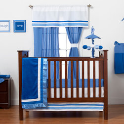 """Simplicity Blue - Infant Set (4pc) - Let your personality come to life in a room filled with sophistication and style.  Simplicity Blue is nothing too simple for you!  Beautiful hues of blue with white throughout make the most of this set.  This 4pc set includes:  4pc bumper, crib bed skirt, crib sheet, and a coordinating medium quilt.  4pc bumper is a combination of """"One Grace Place"""" designer cotton print fabric and soft minky fabric.  Bumper is simplistic in detail with  front in elegant lines in white and both colors of blue -- all in cotton print fabric.  Back is in our darker blue minky with welting and ties in lighter blue.  Bed skirt repeats our bumper design with lines of white and both color blues in cotton print fabric.    Crib sheet accents this collection in our designer cotton print fabric --  """"Blue Dots"""".  Simplicity Blue coordinating quilt is an overall universal quilt like no other.  Soft minky on both sides make this the perfect blanket anytime and anywhere!  Darker blue minky on both sides with accents framed in white and trimmed in our light blue satin trim.  Not only does this quilt coordinate with the entire set you can also enjoy using this outside the crib and for years to come!  SAVE WHEN YOU BUY AS A SET!"""