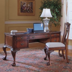 Hooker Claw Writing Desk with Optional Chair - Cherry - Whether you're sitting down to write a business e-mail or pen a sweet little love note the Hooker Claw Writing Desk with Optional Chair - Cherry has a solution for every task. Multifunctional drawers provide modern storage options and a rich finish and elegantly rendered detail set the scene for both business and pleasure. The desk is crafted from super-durable hardwood solids and cherry veneers finished in a warm burnished cherry shade with luminous variegations. The center drop-front drawer can be used as a keyboard or laptop tray. One drawer is outfitted to store letter or legal files and two utility drawers with a mouse pad drop-in keep all your supplies within easy reach. Faux leather inserts richen the spacious desktop while carved trim decorative pieced detail and bold claw-style feet lend Old-World style to this perfectly modern office piece. About the optional desk chair Striking desk chair with filigree back and padded seat Durable hardwood solids Burnished cherry finish with light neutral upholstery Shaped legs with ball claw feet in front Dimensions: 20W x 25D x 41.5H inches Not available for sale in or delivery to the state of California. About Hooker Furniture CorporationFor 83 years Hooker Furniture Corporation has produced high-quality innovative home furnishings that seamlessly combine function and elegance. Today Hooker is one of the nation's premier manufacturers and importers of furniture and seeks to enrich the lives of customers with beautiful trouble-free home furnishings. The Martinsville Virginia based company specializes in lifestyle driven furnishings like entertainment centers home office furniture accent tables and chairs.