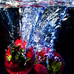 """""""Submerged Forever"""" Artwork - Strawberries dive into water creating a still life image. the red color of the fruit creates a vivid contrast to the black background. the splashing and movement of water gives the image an abstract quality to it.  all images are available in the following sizes: 13x19 unframed on luster photographic paper - 17x25 unframed on luster photographic paper - 20x30 printed on metallic and mounted on plexiglass -$1100 limited to 9 artist proof editions in a particular size. they will be signed and numbered on the back of the image. i print all images using the latest technology, the highest-quality papers, and newest archival inks. additionally, i include a 5mm white border to ensure proper handling that eliminates the potential for fingerprints."""