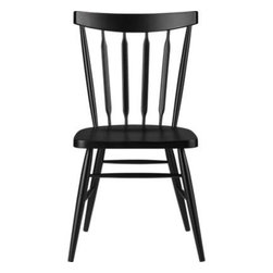 Willa Raven Side Chair - The ever-popular Windsor chair sits up and gets noticed in deep raven black. Beechwood frame brings the design up to date with slender spindle back, angled legs and subtle saddle seat. Mix with other Willa Chair color options for a fresh take on table seating or pull up solo to desk or vanity.