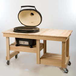 Primo - Primo Oval Large Kamado Grill with Counter Top Table Cart Multicolor - AMK316 - Shop for Grills from Hayneedle.com! The Primo Oval Large Kamado Grill with Counter Top Table Cart will easily become your favorite place to cook. This combo includes a spacious cypress cart with smooth rolling casters that lock in place. A lower shelf is perfect for an extra bag of charcoal. The spacious countertop is the ideal place to prep food or hold a cold one. The Kamado Grill gives you the best of both worlds as it can be used as a smoker or high quality grill. It features its signature shape glazed porcelain ceramic shell and comes complete with a multi-level grate for versatile cooking. Other features include a cast iron chimney vent reversible cooking grate stainless steel lower vent door built-in thermometer and lift-and-lock hinge system. About PrimoPrimo understands more about the amazing things that happen when flame and good food meet. For the last 70 years they've set out to create the singularly best way to cook food outdoors using the highest-quality materials innovative design and an absolutely relentless pursuit of perfection. With a complete line of luxury-grade grills burners accessories and built-in grill island components Primo is ready to turn your home into the world's best outdoor kitchen.
