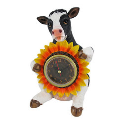 `Chronos Moo` Tabletop Holstein Cow and Sunflower Clock - This cute countertop clock features a black and white cow, holding a bright and cheerful sunflower. The center of the sunflower holds a 2 3/4 inch diameter clock that features quartz movement and pulls straight out to set the time and install a AAA battery (not included). This piece is made of cold cast resin and measures 7 1/2 inches tall, 5 1/2 inches wide, and 5 1/4 inches deep. Each one is hand-painted, and is part of a limited edition of only 5000 pieces. It is a lovely accent in a country kitchen, and makes a great gift for cow collectors.