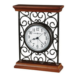 Howard Miller - Howard Miller Mildred Quartz Alarm Clock - Howard Miller - Alarm Clocks - 645632 - This traditional contemporary alarm clock is steeped in classic design detail and will be an admirable addition to any mantel or table top. Distinguished by its decorative metal scroll work paneling, molded cherry hardwood base and crown and classic floating dial, the Mildred has an attractive depth of character. A protective full felt bottom and quartz alarm movement complete the appeal of the Mildred Quartz Alarm Clock.