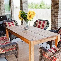 Outdoor Furniture - This is a picture of our popular Mesquite Table.  This particular model features our custom Light Reclaimed Wood finish, and can be made in an array of different levels of distress--natural imperfections, light distress and heavy distress, but typically has a rough finish to it.  This same finish can also applied to any of our tables including our trestle table, The Corinth.