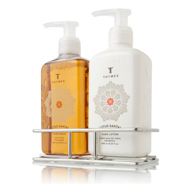 Lotus Santal Sink Set with Caddy 8.25 oz. - Keep hands soft and well-cared for with the Lotus Santal Sink Set with Caddy, a useful pairing of liquid hand wash and creamy hand lotion packaged in signature bottles that fit neatly into a versatile silver wire basket. A narrow profile lets the set balance easily close to hand, where its rich scent - a woody attar with exotic fragrances lending spice and sweetness - can ease and add excitement to your day.