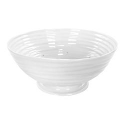 Portmeirion - Sophie Conran White Footed Drainer - 422490 - Shop for Bowls and Candy Dishes from Hayneedle.com! Use the Sophie Conran White Footed Drainer once and you'll never use a plastic drainer again. Crafted of durable porcelain this versatile drainer can withstand almost any temperature. When you are finished preparing your meal pop it in the dishwasher for easy cleanup.About PortmeirionStrikingly beautiful eminently practical refreshingly affordable. These are the enduring values bequeathed to Portmeirion by its legendary co-founder and designer Susan Williams-Ellis. Her father architect Sir Clough Williams-Ellis was the designer of Portmeirion the North Wales village whose fanciful architecture has drawn tourists and artists from around the world (including the creators of the classic 1960s TV show The Prisoner). Inspired by her fine arts training and creation of ceramic gifts for the village's gift shop Susan Williams-Ellis (along with her husband Euan Cooper-Willis) founded Portmeirion Pottery in 1960. After 50+ years of innovation the Portmeirion Group is not only an icon of British design but also a testament to the extraordinarily creative life of Susan Williams-Ellis.The style of Portmeirion dinnerware and serveware is marked by a passion for both pottery manufacturing and trend-setting design. Beautiful tactile nature-inspired patterns are a defining quality of Portmeirion housewares from its world-renowned botanical designs modeled on antiquarian books to the breezy natural colors of its porcelain and earthenware. Today the Portmeirion Group's design legacy continues to evolve through iconic brands such as Spode the Pomona Classics collection and the award-winning collaboration of Sophie Conran for Portmeirion. Sophie Conran for Portmeirion:Successful collaborations have provided design inspiration throughout Sophie Conran's life. Her father designer Sir Terence Conran and mother food writer Caroline Conran have been the pillars of her eclectic mix 