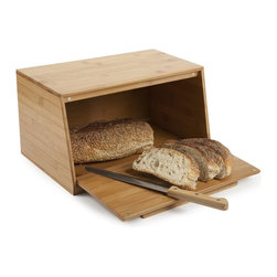 Bamboo Bread Box - Stylish, sophisticated and versatile enough to compliment any décor, this bamboo bread box has a pull out door that also serves as a cutting surface for all of your favorite breads. Crafted from 100% organically grown bamboo, this bread box is the perfect edition to any kitchen.