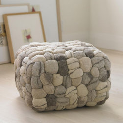 Soft Stone Pouf - This soft pouf is, ironically, made up of river stone replicas! Who would expect cushy felt and rocks would inspire such a piece?
