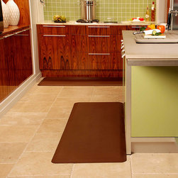 Frontgate - WellnessMats Anti-Fatigue Mat - Made with revolutionary Advanced Polyurethane Technology (APT) that provides elasticity and resilience. 50% more fill material than other mats. Lightweight, strong, and durable. Measures 3/4-inch thick. No-trip beveled edges will never curl. Our WellnessMats Anti Fatigue Mat has a remarkably resilient core, providing safety and comfort to those required to stand for long periods of time. This is the mat of choice for several hotels, airports, professional kitchens, and retailers. . . . .  . Designed to be anti-microbial and puncture, heat, and stain resistant . Easy to clean . PVC-free construction is safe and non-toxic . Comprehensive 7-year warranty; view details.