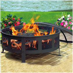 Bravo Wood-burning Fire Pit - The round shape of this fire pit is perfect for a small gathering of friends, and the wire mesh on the sides and top make it both safe and sophisticated.
