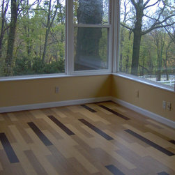 Holistic Retreat, Cincinnati - This floor mixes natural, carbonized and stained bamboo planks for a unique pattern.