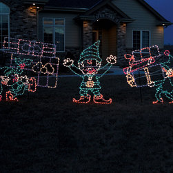 Frontgate - Set of Three Outdoor Lighted Elves - Outdoor Christmas Decorations - Durable, rust-resistant powdercoated steel frames. Lights are securely hand-wound around each frame. Mount to a structure or stake in ground. Polymer UV-coated domes shield lights from damage and fading. Stakes included. Two elves carrying packages and one elf playing director are all it takes to get your lawn in the holiday spirit. The brightly lit Set of Three Outdoor Lighted Elves are crafted by a company who specializes in commercial lighted displays.. . . . . UL approved. 4 ft. cord. Residential or commercial use.