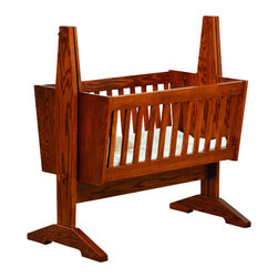 Chelsea Home Furniture - Chelsea Home Dorset Mission Baby Cradle Pad not Included in Red Oak - Crafted in Old World Mission style, this 19th century inspired baby cradle is handmade both solid and strong to easily lull your baby to sleep night after night. Shown in red Oak with Old World Mission stain, the cradle has sturdy vertical slats and emphasizes the natural marble-like quality in the wood _ perfect for passing down from generation to generation. Chelsea Home Furniture proudly offers handcrafted American made heirloom quality furniture, custom made for you. What makes heirloom quality furniture? It's knowing how to turn a house into a home. It's clean lines, ingenuity and impeccable construction derived from solid woods, not veneers or printed finishes over composites or wood products _ the best nature has to offer. It's creating memories. It's ensuring the furniture you buy today will still be the same 100 years from now! Every piece of furniture in our collection is built by expert furniture artisans with a standard of superiority that is unmatched by mass-produced composite materials imported from Asia or produced domestically. This rare standard is evident through our use of the finest materials available, such as locally grown hardwoods of many varieties, and pine, which make our products durable and long lasting. Many pieces are signed by the craftsman that produces them, as these artisans are proud of the work they do! These American made pieces are built with mastery, using mortise-and-tenon joints that have been used by woodworkers for thousands of years. In addition, our craftsmen use tongue-in-groove construction, and screws instead of nails during assembly and dovetailing _both painstaking techniques that are hard to come by in today's marketplace. And with a wide array of stains available, you can create an original piece of furniture that not only matches your living space, but your personality. So adorn your home with a piece of furniture that 