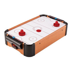 Mainstreet Classics - Table Top Air Powered Hockey - Table Top Air Powered Hockey Game. Mini air hockey rink with dual end puck return. Manual scoring. Battery operated. Solid air flow provides realistic air hockey action. Includes 2 pushers and 1 puck. Runs on double AA batteries so no power cord is necessaryGet ready for a fast paced battle right at your table. This will bring hours of entertainment as it would a normal sized air hockey table, but without breaking the bank. Plus, it can be easily store out of sight when not in use. Bring this game on the road or to any social event. Mainstreet Classics brings back the games of years past to provide hours of family fun.
