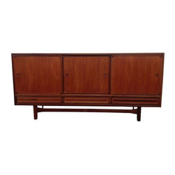 Pre-owned Danish Modern Teak Sideboard - Hold it right there...in this classy and classic solid teak credenza featuring lovely green felt lined drawers and shelves and incised pulls. All drawers and sliding doors work perfectly.