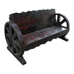 Mesquite Wood Wagon Wheel Bench - Mesquite Wood Wagon Wheel Bench made from solid old mesquite wood and has ornate iron accents. This bench will take center stage no matter where you place it. You can rest assure that no one will have a bench like this. It is a one-of-a-kind, Tres Amigos exclusive. This Mesquite Wagon Wheel Bench will add rustic charm to any outdoor space or would make a great conversation bench inside your house.*Extra Large Packaging fee may apply. Not all Benches will look the same. Call for pictures of in-stock items. Please note that long wait times could be possible if this item is not in stock at the time of order.