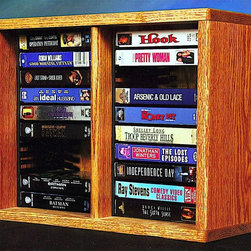 Wood Shed - Desktop VHS Storage w Individual Locking Slot - Finish: UnfinishedTwo shelves. Capacity: 20 VHS. Made from solid oak. Honey oak finish. 14.25 in. W x 7 in. D x 18 in. H