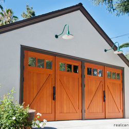 Carriage Garage Doors - Outswing garage doors on a carriage house.