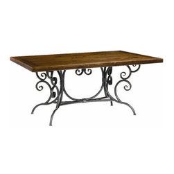 Waterbury Dining Table, Iron - Love the twists and turns. A perfect mix of an ornately forged base, paired with a distressed top. You won't want to hide this table under a tablecloth, but add more scuffs and scrapes to the top.