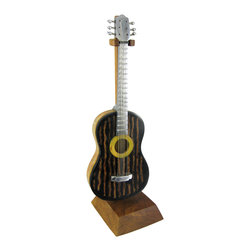 Zeckos - Recycled Aluminum Acoustic Guitar Sculpture Coconut Body - This cool miniature acoustic guitar sculpture features a recycled aluminum neck, metal wrap tuners, metal strings, a bamboo body, and has a face made from coconut shell. The guitar measures 8 1/4 inches long, 3 inches wide and 3/4 of an inch deep. The detail is incredible, down to the round bead caps on the tuners. It comes with a 9 1/4 inch tall wooden hanging stand. It makes a great gift for anyone who loves acoustic guitars.
