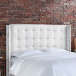 "Skyline Furniture - Nail Button Tufted Microsuede Wingback Headboard - This handmade wingback headboard, upholstered in a soft micro-suede is trimmed with fashionable nail buttons. Its unique design will add a modern feel to any bedroom. Attaches to any standard metal frame. Features: -Solid pine frame, metal legs, polyester fill foam, polyurethane foam.-Spot clean only.-Made in the USA.-Nail Button Tufted collection.-Gloss Finish: No.-Frame Material: Pine wood.-Hardware Material: Steel.-Wall Mounted: No.-Reversible: No.-Media Outlet Hole: No.-Built In Outlets: No.-Hardware Finish: Black metal.-Finished Back: No.-Distressed: No.-Hidden Storage: No.-Freestanding: No.-Frame Included: No.-Drill Holes for Frame: Yes.-Commercial Use: No.-Recycled Content: No.Specifications: -EPP Compliant: No.-CPSIA or CPSC Compliant: Yes.-CARB Compliant: Yes.-JPMA Certified: No.-ASTM Certified: No.-ISTA 3A Certified: Yes.-PEFC Certified: No.-General Conformity Certificate: Yes.-Green Guard Certified: No.Dimensions: -Overall Height - Top to Bottom (Size: California King): 56"".-Overall Height - Top to Bottom (Size: Full): 56"".-Overall Height - Top to Bottom (Size: King): 56"".-Overall Height - Top to Bottom (Size: Queen): 56"".-Overall Width - Side to Side (Size: California King): 79.5"".-Overall Width - Side to Side (Size: Full): 61.5"".-Overall Width - Side to Side (Size: King): 83.5"".-Overall Width - Side to Side (Size: Queen): 67.5"".-Overall Depth - Front to Back (Size: California King): 8"".-Overall Depth - Front to Back (Size: Full): 8"".-Overall Depth - Front to Back (Size: King): 8"".-Overall Depth - Front to Back (Size: Queen): 8"".-Overall Product Weight (Size: California King): 63 lbs.-Overall Product Weight (Size: Full): 56 lbs.-Overall Product Weight (Size: King): 68 lbs.-Overall Product Weight (Size: Queen): 61 lbs.-Leg Height: 6"".-Bottom of Headboard to Floor: 24"".Assembly: -Assembly Required: Yes.-Tools Needed: Allen wrench, wrench.-Additional Parts Required: No.Warranty: -1 Year limited warranty.-Product Warranty: 1 Year limited (Excludes fabric)."