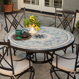 Belham Living - Patio Dining Set: Palazetto Barcelona 48-in. Round Mosaic Patio Dining Set -Seat - Shop for Tables and Chairs Sets from Hayneedle.com! Additional features:Dining chairs: 19L x 22.5W x 40.25H inchesDining chair weight: 15 lbs. (ea)Dining table: 48 diameter inchesDining table weight: 75 lbs.Comfortable spacious chair seat and supportive diamond motif backTraditional Italian design for the modern homeEasy maintenance - wipes clean with mild dish soap and waterWater- and UV-resistant foam seat cushions wrapped in DacronUmbrella hole for a standard 1.5-inch diameter umbrella poleTable top plug for use without an umbrellaEasy to assembleSeats 4 peopleAvailable exclusively at Hayneedle.comWith its traditional Italian design and timeless appeal the Palazetto Barcelona 48 in. Round Mosaic Patio Dining Set will get you plenty of compliments on your impeccable taste. Perfect for enjoying al fresco dinners with family and friends this wrought iron dining set adds a stylish upscale look to any outdoor setting. And the best part is that since this dining set which includes a 48-inch dining table and four chairs is exclusive only to Hayneedle.com you get all the compliments at almost half the price you'd be paying for a similar item in a retail store.Hand-laid mosaic tiles combine with hand-forged wrought iron to create a look that's decidedly eye-catching. Jewel-toned shades of blue and green are accented with beige and brown earth tones to bring a warm welcoming feel to your outdoor dining area. And because these tiles are hand-set each Barcelona table is truly one of a kind! Next the top is finished and sealed with an industrial-grade sealant called Fluorocarbon for superior protection. This means if the table top get wets the grout won't dry out and crack like traditional standard grout would. Wear and tear of elements over time may lead to blistering of the silicone top seal and natural aging of the tile materials giving the table an aged look.Built to last the hand-forged wrought iron table base and chair frames are dipped in a zinc-phosphate bath and then E-coated to help create a weather-resistant coating to delay the onset of rust. All wrought iron pieces are quality-checked for strength and durability while iron welds are ground for aesthetic appeal. Finally a powder-coated dark bronze finish is applied and baked onto the iron for stronger color and protection.Not to be outdone in the comfort department the chairs are generously proportioned and feature supportive diamond-motif backs gracefully curved legs and scrolled armrests. Beige seat cushions with chair ties will envelop you in luxurious comfort inviting you to linger at the table way longer than usual. The seat cushions are foam-wrapped in Dacron. Inner cover is a white polyester bag and outer fabric cover is a polyester-cotton mix which is water- and UV-resistant. You'll also love the fact that the dining table has an umbrella hole so you can pair it with a standard patio umbrella (1.5-inch-diameter pole) on particularly hot days. It also comes with a plug for the table top for when an umbrella is not being used.About PalazettoBlending the lines between interior and exterior decor Palazetto furnishings are designed to bring the indoors out. Palazetto believes alfresco living should be enjoyed by all and they center this belief on beautiful cast aluminum and wrought iron pieces and stunning outdoor mosaics designed to warm your patio and soothe your senses.The Palazetto collection is available at almost half the price you'd pay for something similar in a retail store so you may be surprised to learn that all mosaic table tiles are hand-set. They're then grouted with industrial adhesives for maximum durability and sealed with an industrial-grade sealant called Fluorocarbon for superior protection. And quality mosaic table tops aren't the only thing they can boast about. Each piece in the Palazetto aluminum and wrought iron collections feature the highest quality construction from rust-proof materials to fully welded joints to weather-resistant powder-coat finishes. You'll be enjoying these sets for years as they can withstand extended outdoor exposure in any climate in any season.So gather up your family and head to the backyard for some quality time around quality furniture. With Palazetto you'll quickly find you're as comfortable here as you were inside.Please note this product does not ship to Pennsylvania.