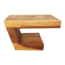 Kammika - Balance Wood End Table 30L x 16W x 18H Monkey Pod - Walnut Oil Finish - Our Sustainable Monkey Pod Wood Balance Table 30 inches length Top, 16 inches Width, and 18 inches height in Eco Friendly Natural Livos Walnut Oil Finish, is a solid piece of Monkey Pod wood with an angled riser from a small base to the larger top slab of wood creating the impression of a balanced piece. While creating the illusion of being precariously balanced, the large top is sturdy and stable. The bottom can be used for a display or storage area also; some turn the table over for a different illusion. This impressive eco friendly functional art piece is finished in hand rubbed rich eco friendly natural, food-safe Livos Walnut Oil that is polished to a matte finish. Color ranges from medium to dark Walnut brown tones that will darken as the wood ages. The natural oils are translucent, so the wood grain detail is highlighted. There is no oily feel and cannot bleed into carpets. This piece serves as an end table, stand, or stool. They can serve as a serving table or bench when put together. Craftspeople from the Chiang Mai area in Northern Thailand create these pieces with the simplest of tools. We make minimal use of electric hand sanders in the finishing process. Dried in solar and or propane kilns, no chemicals are used in the process, ever. Made from the branches of the Acacia tree, each branch is cut and carved to order (allowing the tree to continue growing). After each is carved, kiln dried, sanded, and rubbed with Livos oil, they are packaged with cartons from recycled cardboard with no plastic or other fillers. As this is a natural product, the color and grain of your piece of Nature will be unique, and may include small checks or cracks that occur when the wood is dried. Sizes are approximate. Products could have visible marks from tools used, patches from small repairs, knot holes, natural inclusions or holes. There may be various separations or cracks on your piece when it arrives. There may be some slight variation in size, color, texture, and finish. Only listed product included.