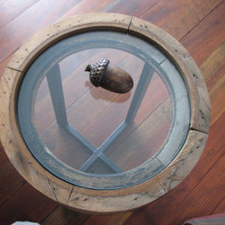 re-tooled - Old circular window with new glass top, custom welded iron base