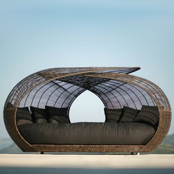 Spartan Outdoor Wicker Pod - The Spartan outdoor wicker pod has a thick, deep seating cushion and if 109'' long and 57'' wide.