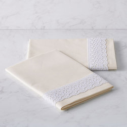 Frontgate - Set of Two Cornova Pillowcases - 400-thread count percale fabric woven in Italy from long-staple Egyptian cotton. Matte ivory finish with Italian-made cotton lace overlay. Versatile, medium-weight fabric. Machine wash, tumble dry on low heat; see product label for further instructions. Delicate lace trim dresses ivory fabric with a feminine touch in this elegant collection from the esteemed Italian purveyor, SFERRA. The 400-thread count percale bedding is woven from the highest-quality Egyptian cotton, and precisely tailored for a crisp finish with a natural drape. Sumptuous, smooth and remarkably resilient, this premium percale maintains a like-new appearance for years. . . . . Made in Italy.