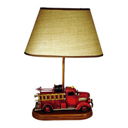 """Lamps Plus - Contemporary Fire Engine Themed 21.75"""" High Table Lamp With Shade - Perfect for a young child's room this novelty table lamp features a handpainted fire engine design in red black and gold finishes. A warm wood plank supports the charming fire engine and a rectangular cloth shade with dark piping around the edges completes the look. From Judith Edwards Designs. Poly resin construction. Handpainted fire engine design. Cloth shade. In-line switch. Takes one 100 watt standard bulb (not included). 21 3/4"""" high. Shade is 9 1/2"""" x 7 1/2"""" across the top 14 1/4"""" x 8"""" across the bottom 9 1/2"""" on the slant.  Poly resin construction.   Handpainted fire engine design.   Cloth shade.   In-line switch.   Takes one 100 watt standard bulb (not included).   21 3/4"""" high.   Shade is 9 1/2"""" x 7 1/2"""" across the top 14 1/4"""" x 8"""" across the bottom 9 1/2"""" on the slant."""