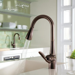 Moen 7594 Single Handle Kitchen Faucet with Reflex Pullout Spray from the Arbor - If there's a single word that describes Moen's Arbor collection, it's simple. This tidy series of pull out spray kitchen faucets is contemporary all the way, and lacks any unnecessary design elements. The sleek, smooth, and straightforward look is punctuated by the spout's high-arc design. The Arbor collection features pull-down kitchen faucets with optional side sprays, and comes in your choice of three finishes.