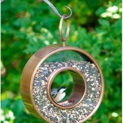 Good Directions Venetian Bronze Steel Fly-Thru Bird Feeder - Birds like to think outside the box, so they'll love the circular Good Directions Venetian Bronze Steel Fly-Thru Bird Feeder. So will you. This feeder hangs easily, looks great, and holds 5 pounds of delicious bird food. Delicious for birds, of course.About Good DirectionsGood Directions got its start by creating weathervanes and cupolas, but it has expanded its line to include a wide range of decorative yet functional products for the home and garden, including popular Fire Domes, rain chains, and garden weathervanes. The company continues to attract innovative artists and designers eager to lend their vision to the creation of exceptional products to enhance the home, both indoors and out. No matter which way the wind blows, you can count on Good Directions to show you the way to a beautiful home.