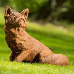 Campania International Noble Fox Garden Statue - Let the Campania International Noble Fox Garden Statue watch over your garden space. This handsome fox features incredibly realistic details that bring his personality to life and he is just the right size to make a statement in any setting. This statue is durable enough to withstand life outdoors because it's handcrafted of weather-resistant cast stone concrete that undergoes an intensive 15-step process to make each detail perfect. It's available in several finish options and comes unsealed so your fox can naturally develop an antique patina as it ages.About Campania InternationalEstablished in 1984, Campania International's reputation has been built on quality original products and service. Originally selling terra cotta planters, Campania soon began to research and develop the design and manufacture of cast stone garden planters and ornaments. Campania is also an importer and wholesaler of garden products, including polyethylene, terra cotta, glazed pottery, cast iron, and fiberglass planters as well as classic garden structures, fountains, and cast resin statuary.Campania Cast Stone: The ProcessThe creation of Campania's cast stone pieces begins and ends by hand. From the creation of an original design, making of a mold, pouring the cast stone, application of the patina to the final packing of an order, the process is both technical and artistic. As many as 30 pairs of hands are involved in the creation of each Campania piece in a labor intensive 15 step process.The process begins either with the creation of an original copyrighted design by Campania's artisans or an antique original. Antique originals will often require some restoration work, which is also done in-house by expert craftsmen. Campania's mold making department will then begin a multi-step process to create a production mold which will properly replicate the detail and texture of the original piece. Depending on its size and complexity, a mold can take as long as three months to complete. Campania creates in excess of 700 molds per year.After a mold is completed, it is moved to the production area where a team individually hand pours the liquid cast stone mixture into the mold and employs special techniques to remove air bubbles. Campania carefully monitors the PSI of every piece. PSI (pounds per square inch) measures the strength of every piece to ensure durability. The PSI of Campania pieces is currently engineered at approximately 7500 for optimum strength. Each piece is air-dried and then de-molded by hand. After an internal quality check, pieces are sent to a finishing department where seams are ground and any air holes caused by the pouring process are filled and smoothed. Pieces are then placed on a pallet for stocking in the warehouse.All Campania pieces are produced and stocked in natural cast stone. When a customer's order is placed, pieces are pulled and unless a piece is requested in natural cast stone, it is finished in a unique patinas. All patinas are applied by hand in a multi-step process; some patinas require three separate color applications. A finisher's skill in applying the patina and wiping away any excess to highlight detail requires not only technical skill, but also true artistic sensibility. Every Campania piece becomes a unique and original work of garden art as a result.After the patina is dry, the piece is then quality inspected. All pieces of a customer's order are batched and checked for completeness. A two-person packing team will then pack the order by hand into gaylord boxes on pallets. The packing material used is excelsior, a natural wood product that has no chemical additives and may be recycled as display material, repacking customer orders, mulch,or even bedding for animals. This exhaustive process ensures that Campania will remain a popular and beloved choice when it comes to garden decor.Please note this product does not ship to Pennsylvania.